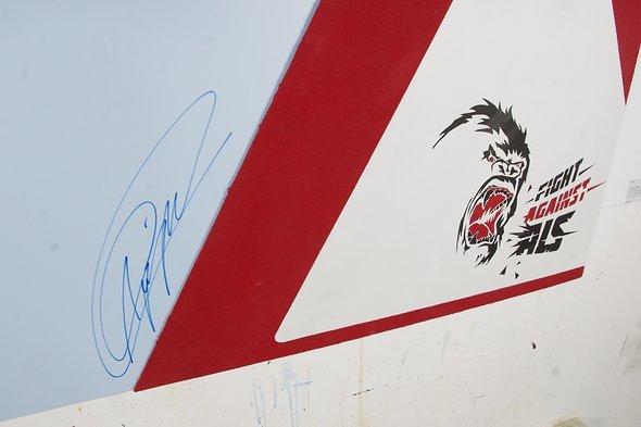 Signatur und Logo von Andrè Greipel